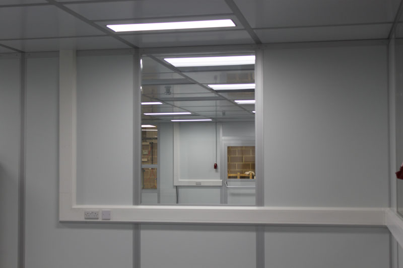 Semi-flush fit cleanroom windows