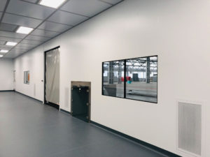 Trolley pass-through unit and fully-flush windows